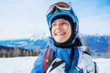 Portrait of Girl snowboarder enjoys the winter ski resort. - 243700523