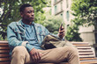 Young african-american with mobile phone outdoors