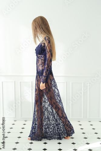 Leinwanddruck Bild Woman is posing in a dress
