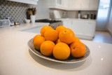 Fresh oranges in plate at home - 243703925