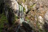 Autumn view of Samodivsko praskalo waterfall, Rhodope Mountains, Bulgaria