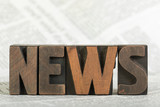 News, word written with letterpress printing blocks on newspaper - 243704998