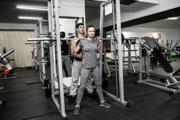 Man instructor working with woman in gym © alfexe
