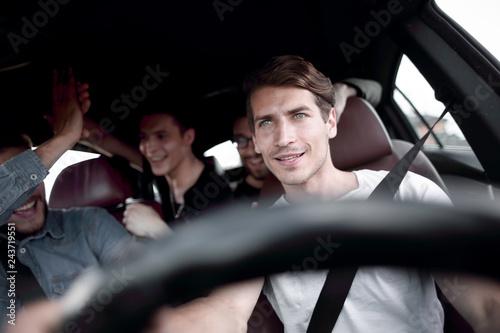 Leinwandbild Motiv A group of people inside a car, on a road trip