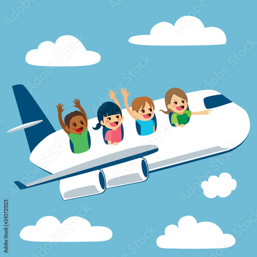 Four cute little children traveling with plane on school trip - 243720123