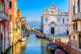 Narrow canal with bridge in Venice, Italy. Architecture and landmark of Venice. Cozy cityscape of Venice. - 243720569