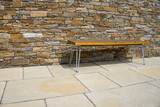 Bench on a stone terrace - 243726124