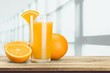 Orange juice and slices of orange on background