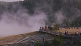 Yellowstone National Park circa-2018.  Tourists walking along paths by geysers at Yellowstone National Park - 243732153