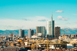 Milan skyline with modern skyscrapers in Porta Nuova business district in Italy. Panoramic view of Milano city. The mountain range of the Lombardy Alps in the background. - 243732746