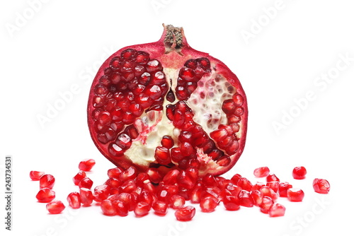 Pomegranate cut in half with seeds isolated on white background
