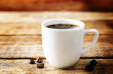 Cup of hot black coffee with coffee beans - 243742314