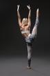 Slim blonde practicing yoga rearview