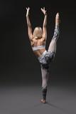 Slim blonde practicing yoga rearview - 243747304