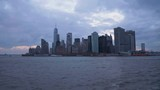 Manhattan Urban Skyline at Cloudy Evening. New York City. View From the Boat. Upper New York Bay. Camera Tilts Up - 243752512