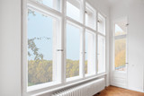 big wooden windows in apartment room of old building - 243755742