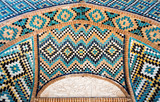 Beautiful decoration in turquoise blue tiled mosaic with geometric motifs, Shah Nematollah Vali Shrine, Iran