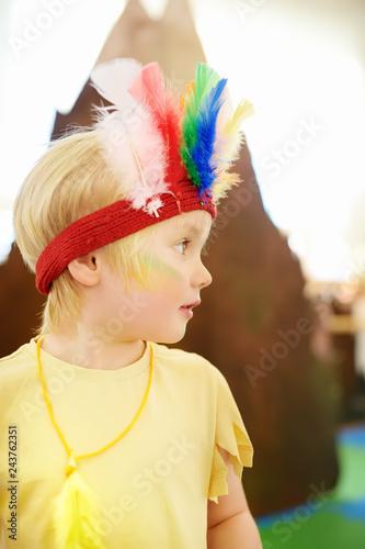 Leinwandbild Motiv Little boy involved in performance children's theatre Studio in the role of the American Indian.