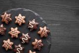Star-shaped chocolates on dark textured background, copy-space - 243770373