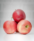 Ripe fresh red apples on table - 243772333