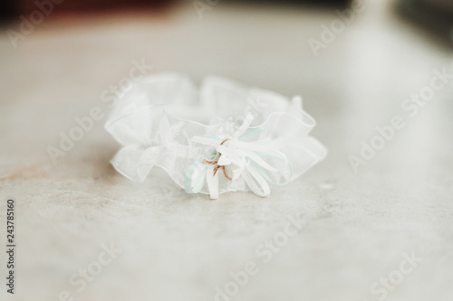 e17cb37a4 fototapeta na ścianę Wedding garter on a white background bridal accessory