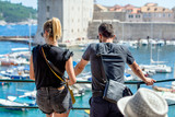 A guy and a girl look at the Marina in Dubrovnik,Croatia.  - 243806903