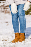 Woman wearing brown winter boots - 243817731