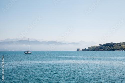 Boat in Mediterranean sea by Italy coast.