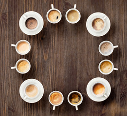 Variety of coffee in ceramic cups. Time for coffee concept. Space for text © Stavros