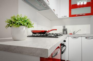 Modern red and white kitchen interior © starush