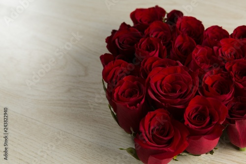 Wall mural Rose flower bouquet on wooden table