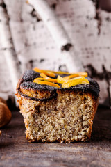 Homemade Citrus Nuts Poppy seed Cake on vintage wooden table. Selective focus