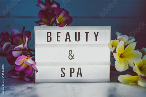 beauty and spe lightbox with frangipani
