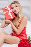 woman holding present box - 243863554