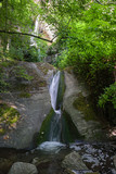 Water cascade of the river Toce among the rocks smoothed in the gorges of the ravines of Uriezzo in val Antigorio, in Piedmont, Italy.