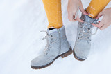 Boots in the snow - 243876946