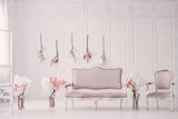 White room with vintage interior and spring flowers