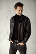 Young handsome man wear black leather jacket and turtleneck