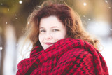 Natural redhead woman with red scarf in winter snow - 243883720