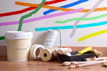 Painting tools for home on parquet floor painted wall background