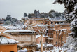 Quadro View of Roman Forum and Palatine ancient ruins covered with snow from Capitoline Hill in Rome