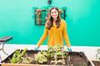 Proud Woman Standing At Urban Garden
