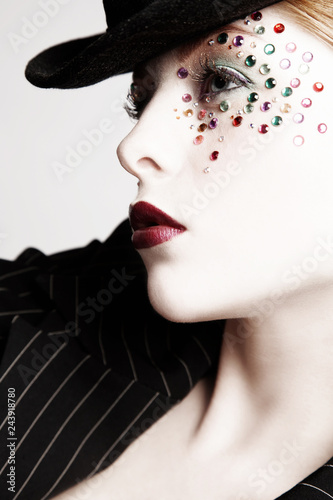 Black and white colored portrait of beautiful girl with fancy makeup, selective focus - 243918780