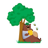 bear under the tree with bee hive and eats honey