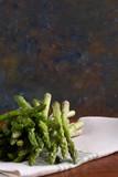 Asparagus  bunch on table on a cloth - 243944335
