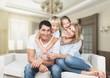 Leinwandbild Motiv Beautiful smiling family sitting at sofa at home