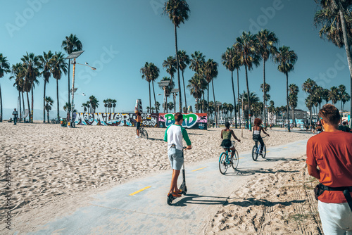 August 10, 2018. Los Angeles, USA. Beautiful summer day at the Venice beach district in LA with people skating, chilling under the palms and shopping. Summer vibes and spirit in LA.