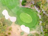 Birds eye view of golf course hole green and sand traps. Drone shot.
