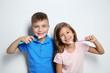 Leinwandbild Motiv Portrait of cute children with toothbrushes on white background