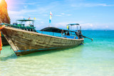 A Thai long tail boat (Rua Hang Yao) on the beach of Andaman sea located at Krabi near Phuket, Thailand - 243990571